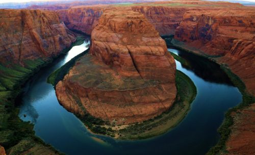 The Colorado River's 290-degree cut through sandstone on its travels to the ocean.